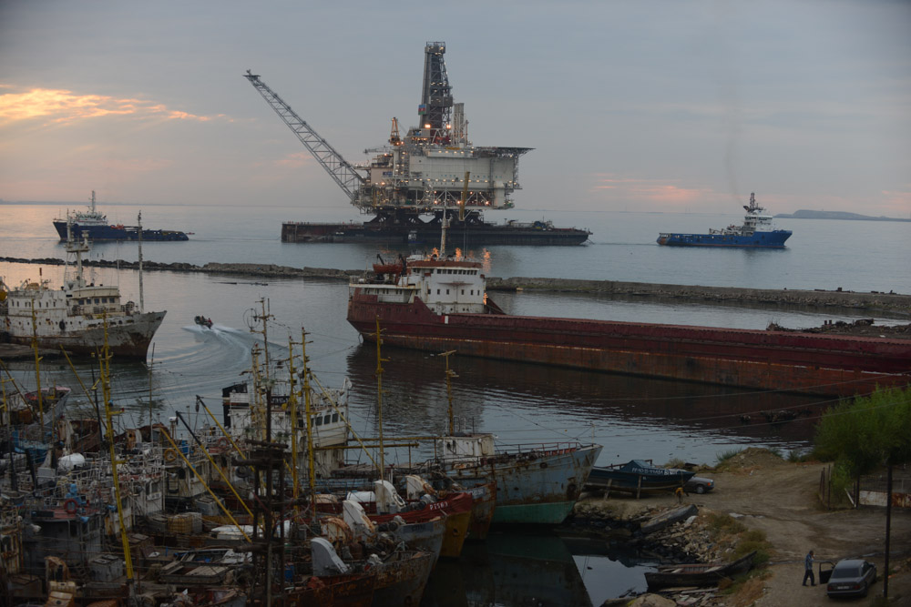 BAKU, AZERBAIJAN.  After two years of construction, a barge hauls the West Chirag offshore oil platform, operated by BP, out into the Caspian Sea in the Bibi Heybat district on September 12, 2013.  The platform will be operational by December 2013 and will see its first returns of crude oil in the spring of 2014.