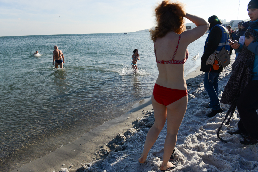 ODESSA, UKRAINE.  Orthodox Christians celebrate epiphany by the seaside with a baptismal-like ritual in frigid temperatures at Lazheron Beach on January 19, 2016.