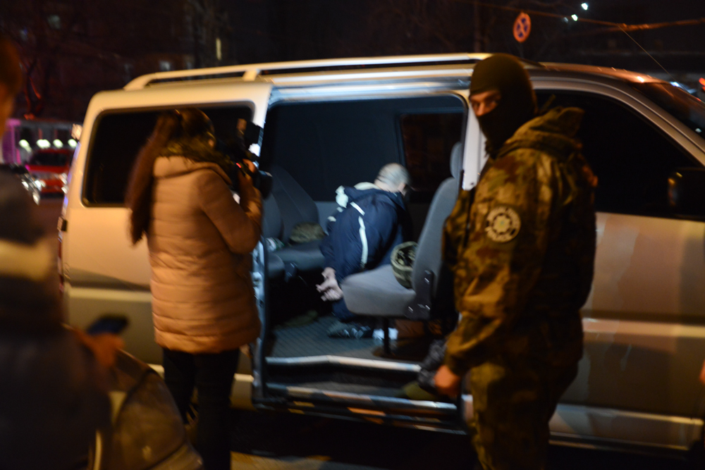 ODESSA, UKRAINE.  Secret service arrest a man as one of their team films the arrest in Odessa, Ukraine on February 22, 2016.
