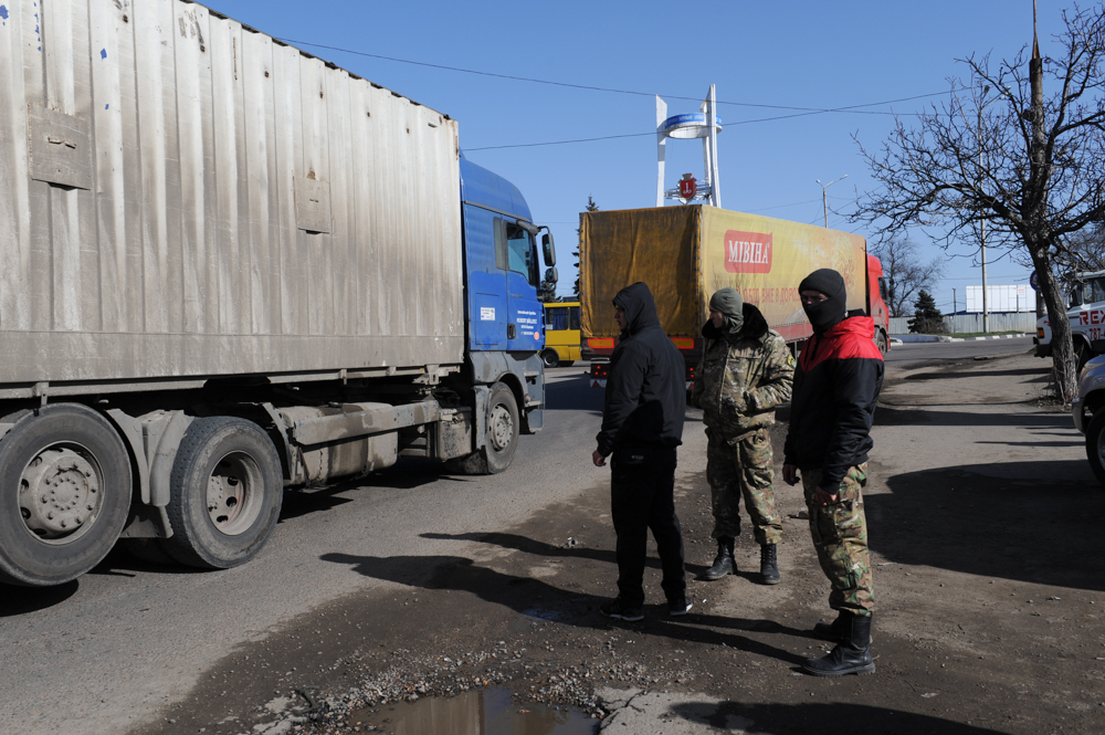 ODESSA, UKRAINE.  A road block set up by Ukrainian pro-Maidan activists and soldiers at the entrance to Odessa from Transdnistria, located 15 kilometers down the road, on February 18, 2016.  Two days prior to this photograph, a truck carrying guns from Russia was stopped from entering Odessa.