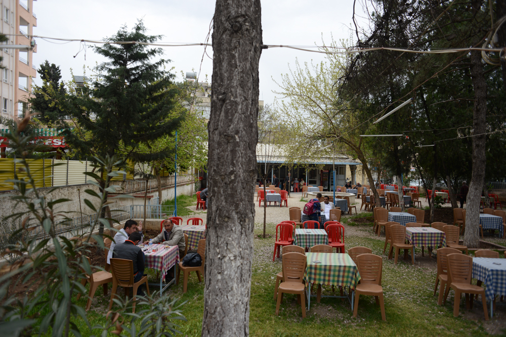KILIS, TURKEY.  An outdoor cafe frequented by Syrians and others around the corner and down the street from the Otel Istanbul on April 4, 2013.  At this moment, Kilis is crowded with Syrian refugees who have made temporary homes in available apartments, motel rooms, and wherever they can really.