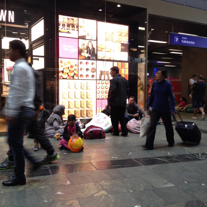 VIENNA, AUSTRIA.  Refugees camped out in front of a cosmetics store at Vienna's central train station on September 21, 2015. As borders across the Schengen zone closed in Austria, Hungary, Germany, and eventually Croatia, bottlenecks in Serbia and getting into Vienna from Hungary then Croatia resulted.