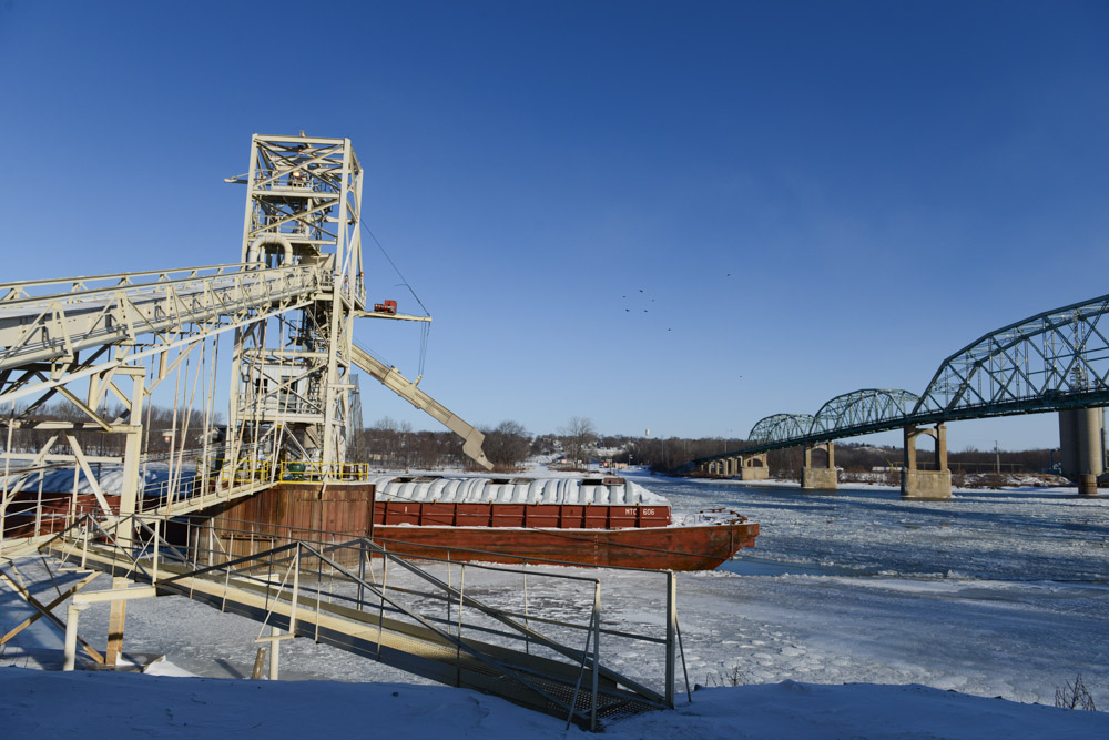 SPRING VALLEY, ILLINOIS.  A barge sits on Illinois River to be loaded with corn and soy at the Cargill riverside facility on January 9, 2014.