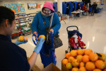 CHICAGO, ILLINOIS.  The Greater Chicago Food Depository runs the Healthy Kids Market which distributes nutritious foods and basic essentials to qualifying parents from the cafeteria of the Calmeca Academy of Fine Arts and Dual Language School in the Brighton Park neighborhood on January 15, 2015.  One in six Chicagoans requires food assistance.