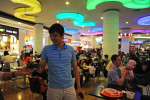 BAKU, AZERBAIJAN.  Asiman Tagili, 20, stands in the middle of the food court at the Park Bulvar shopping mall during a Saturday night out with a friend on April 28, 2012.
