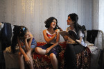 BAKU, AZERBAIJAN.  (Center) Gamar Tagili, 15, is quizzed on biology by her cousin Ayten (right) as her cousin Fatima (left) looks on in the Tagi family bedroom on August 18, 2012.