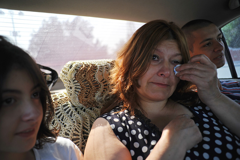 BAKU, AZERBAIJAN.  (L-r) Gamar Tagili, 15, Maila Tagiyeva, 48, and Asiman Tagili, 20, sit in the back seat of a male relatives car as they return back to their apartment after Asiman took his military oath and received his marching orders for that evening on July 5, 2012.
