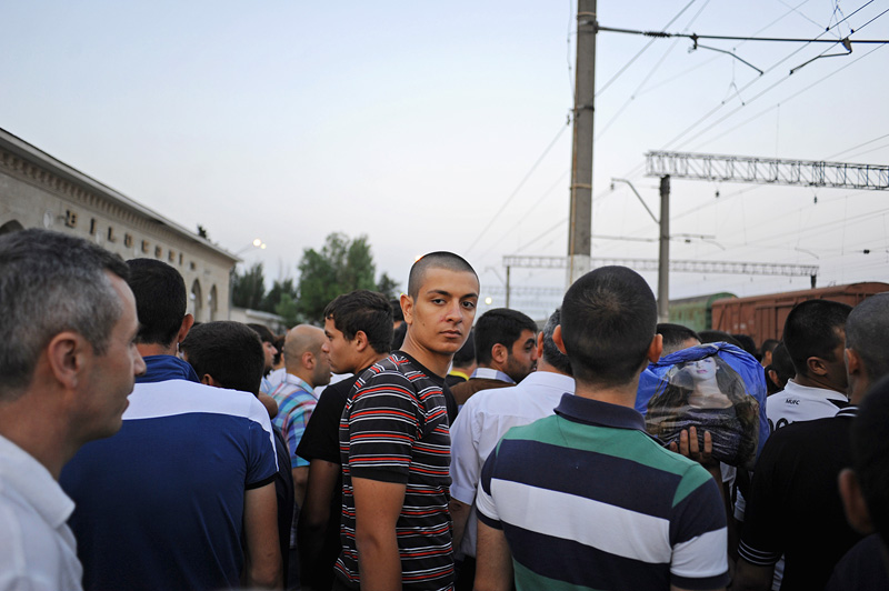 BAKU, AZERBAIJAN.  Asiman Tagili, 20, responds to roll call for young men who are going into the military at the railyard where he will catch a train to Shemkir in western Azerbaijan to fulfill his military service obligtions on July 5, 2012.