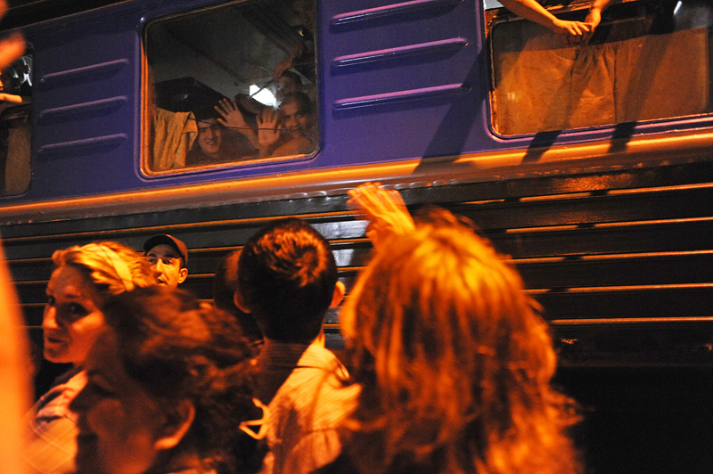 BAKU, AZERBAIJAN.  (Lower right) Maila Tagiyeva, 48, waves to her son, Asiman Tagili, 20, (lower right in the window) after he boarded a train to Shemkir in western Azerbaijan to fulfill his military service obligations on July 5, 2012.
