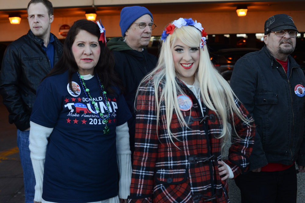 CHICAGO, ILLINOIS. Supporters of Republican Presidential front runner Donald Trump wait in line on the University of Illinois Chicago (UIC) campus to hear Trump speak at an event scheduled for the early evening in Chicago, Illinois on March 11, 2016.  Trump cancelled the event citing a request from the Chicago Police after scuffles broke out between his supporters and protesters, who had claimed a large number of the seats, before he was to speak, something the Chicago Police denied, which maintain they were ready to work the whole night.