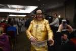 APPLETON, WISCONSIN.  A supporter of Republican presidential frontrunner Donald Trump in an Elvis costume before Trump speaks at the Radisson Paper Valley Hotel on March 30, 2016.