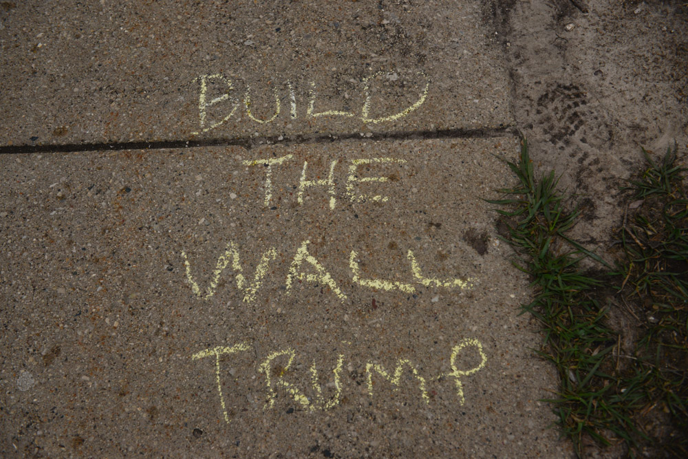 WEST ALLIS, WISCONSIN.  Sidewalk writings in support of one of the key messages of Donald Trump's campaign for the American presidency outside his event at the Nathan Hale High School on April 3, 2016.