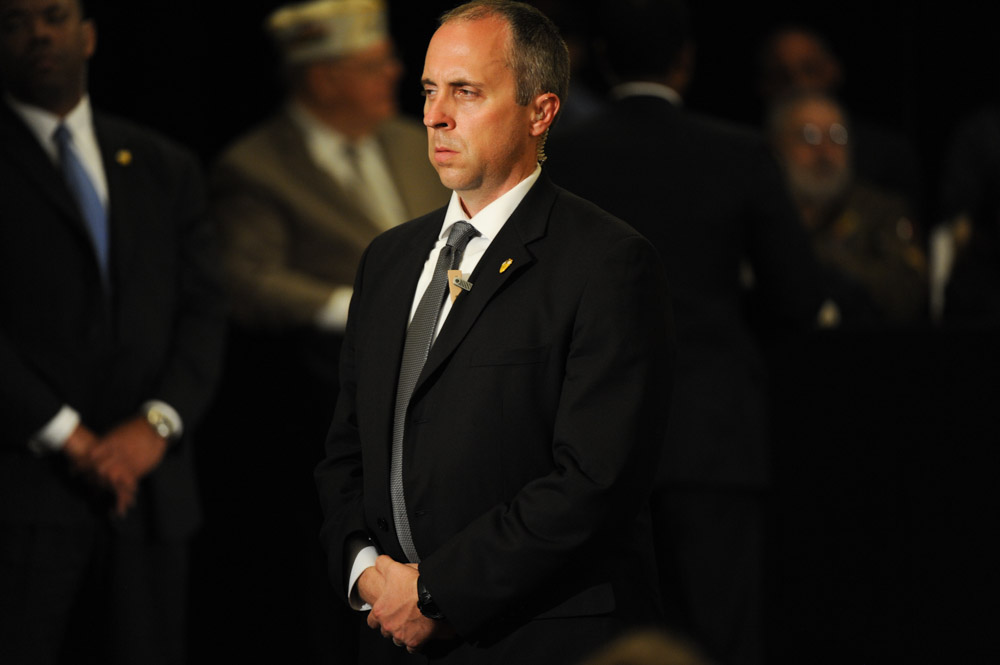 APPLETON, WISCONSIN.  A Secret Service agent stands guard as Republican presidential frontrunner Donald Trump speaks at the Radisson Paper Valley Hotel on March 30, 2016.  After introducing the topic of Syrian refugees and ISIS, Trump read an incendiary poem about a snake that attacks a woman that tried to give it refuge in a clear parable of his views on providing sanctuary to those individuals fleeing the Syrian civil war.