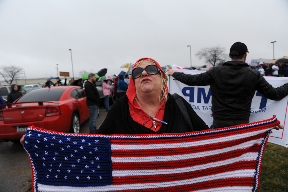 BLOOMINGTON, ILLINOIS.  A Trump supporter revels beside a much larger crowd of demonstrators outside the Synergy Flight Center as Republican front runner Donald Trump speaks on March 13, 2016.
