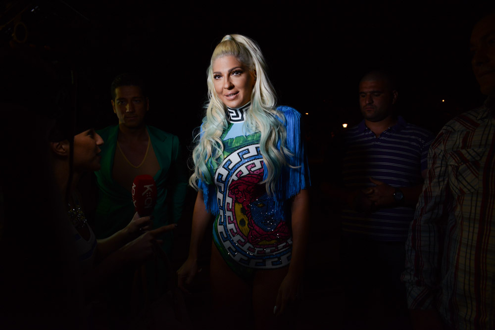 BELGRADE, SERBIA.  Jelena Karleusa arrives in custom Versace according to her Instagram ahead of a concert on the splav, or barge, River on the night of July 3, 2015.  Karleusa is the lone turbofolk star who has been outspoken on the issue of gay rights and many of her looks have been copied by the likes of Lady Gaga, Beyoncé, and Kim Kardashian; in an e-mail Karleusa declared she doesn't sing turbofolk music, despite having deep roots in the industry and coming up through the same television channels, venues and other mechanisms used to promote turbofolk, but refused repeated requests to clarify the description of her music.