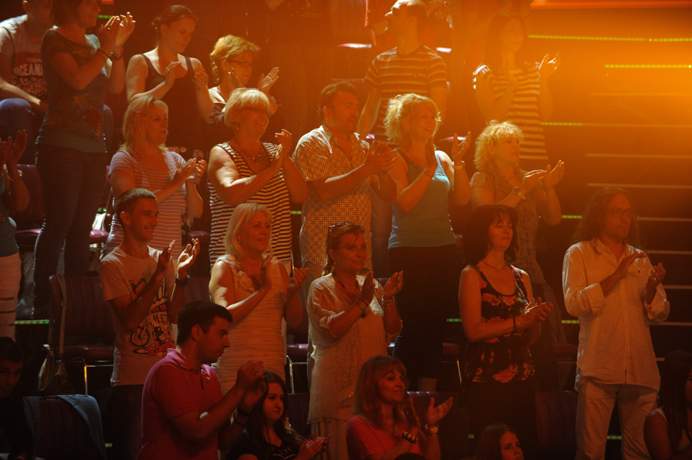 BELGRADE, SERBIA.  Members of the studio audience applaud their favorite stars turbofolk hits on the set of {quote}Zvezde Granda,{quote} or {quote}Grand Stars,{quote} a premier turbofolk showcase on Serbian television station TV Prva, on July 1, 2015.  Members of the studio audience are paid 500 dinars, approximately $5, a day for their role and participation in the tapings which last for hours.