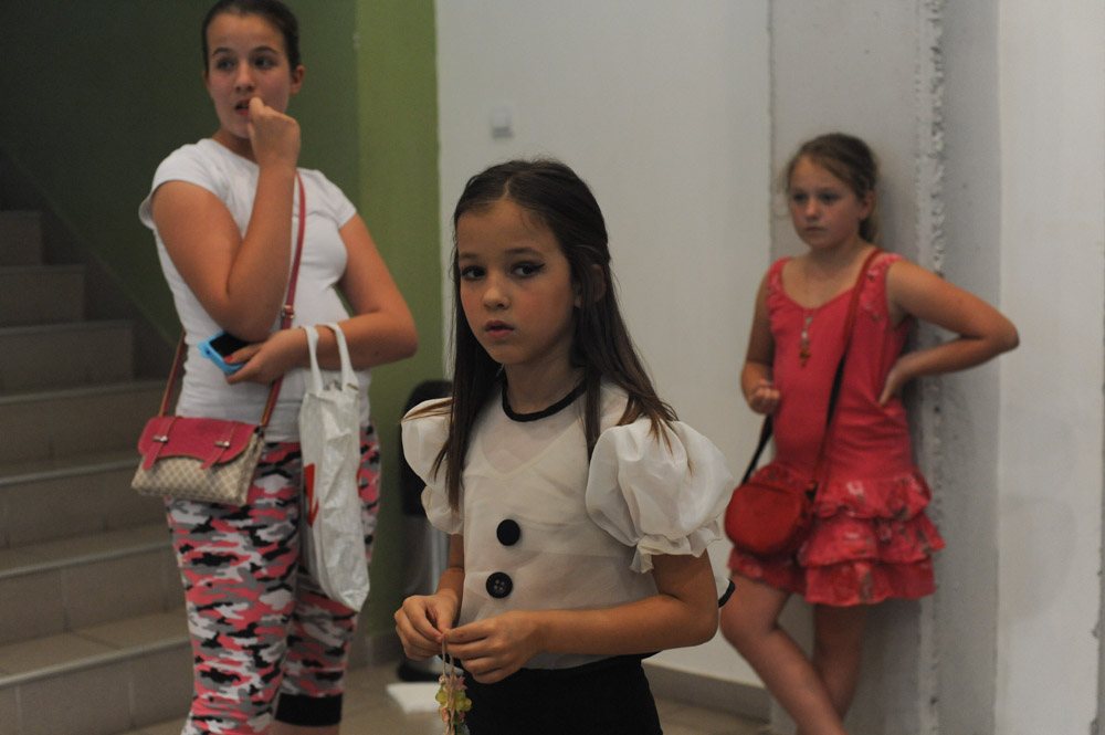 SIMANOVCI, SERBIA.  Girls who will dance on stage during the taping of the finale of {quote}Pinkove Zvezdice,{quote} or {quote}Little Pink Stars,{quote} wait backstage at the Pink TV studios before the finale on July 4, 2015.  {quote}Pinkove Zvezdice,{quote} is the junior program of {quote}Pinkove Zvezde,{quote} the premier turbofolk showcase on Pink TV, one of the primary networks showcasing turbofolk, although the child contestants on {quote}Pinkove Zvezdice{quote} are more likely to sing classic pop songs than anything regional.