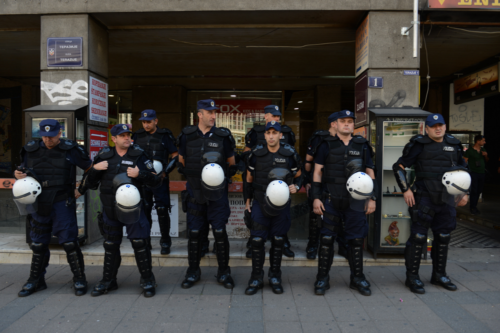 BELGRADE, SERBIA.  Serbian police in riot gear stand guard outside the Media Centar before a commemoration of the 20th anniversary of the Srebrenica massacre, widely labeled genocide in the eyes of International Criminal Court in The Hague and the international community, on July 11, 2015.  Due to threats from nationalists, a planned die-in intended to represent the 8,000 who lost their lives in Srebrenica, Europe's largest postwar massacre, was cancelled and a much smaller commemoration of NGO officials was held at the Media Centar.