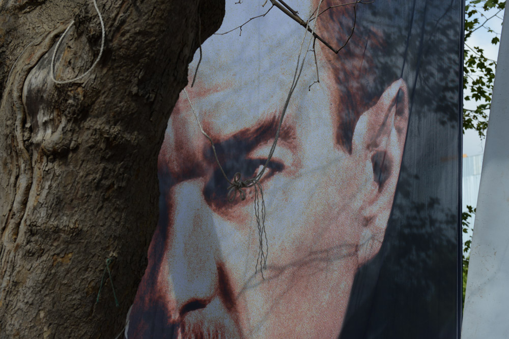 ISTANBUL, TURKEY.  A fragment of a poster of ataturk is seen in Gezi Park after 12 days of occupying the park after police retook the adjacent Taksim Square but left demonstrators in the park on June 13, 2013.   Turkish Prime Minister Recep Tayyip Erdogan has offered a referendum on the park to residents of Istanbul, despite there being no law allowing for such practices, and telling demonstrators to evacuate the park as patience with the demonstration is over.