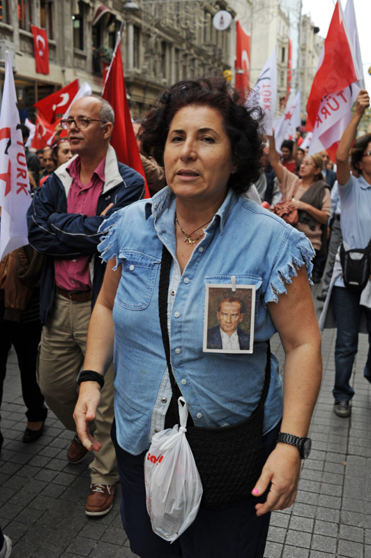 ISTANBUL, TURKEY.  A nationalist demonstrator marces up Istiklal Caddesi from Tunel in support of Ataturk's principles of a secular republic and against the ruling Justice and Development Party, AKP in Turkish, on Republic Day on October 29, 2012.
