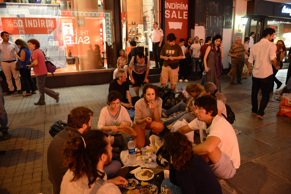 ISTANBUL, TURKEY.  People gather for Iftar dinner on newspapers on Istiklal Street in a show of solidarity with the demonstrators that had previously occupied Gezi Park at the start of Ramadan on July 9, 2013.  Since demonstrators occupied Gezi Park for two and a half weeks last month, police have maintained a heavy presence in Taksim Square and periodic clashes have erupted as demonstrators have returned to the square in protest of Prime Minister Recep Tayyip Erdogan.