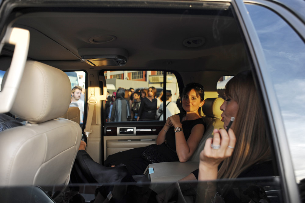 ISTANBUL, TURKEY.  Two women are seen in the backseat of an SUV exiting Istanbul Fashion Week outside Antreppo 3, a warehouse-like venue on the Boshporous in Tophane, after the Soul by Ozgur Masur fashion show on October 12, 2012.