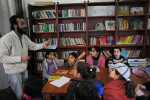 DIYARBAKIR, TURKEY.  Children study Kurdish language and culture and are instructed on their rights by a teacher at the Astrid Lindgren Children's Literature and Culture Center on February 25, 2012.  After nearly a century of forced assimilation policies in Turkey, many Kurds are standing up for their culture and language in a renewed bid for cultural, if not political, independence.
