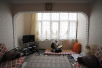 DIYARBAKIR, TURKEY.  A Kurdish woman reads from the Koran in her living room after having recently returned from a pilgrimmage to Mecca on February 28, 2012.