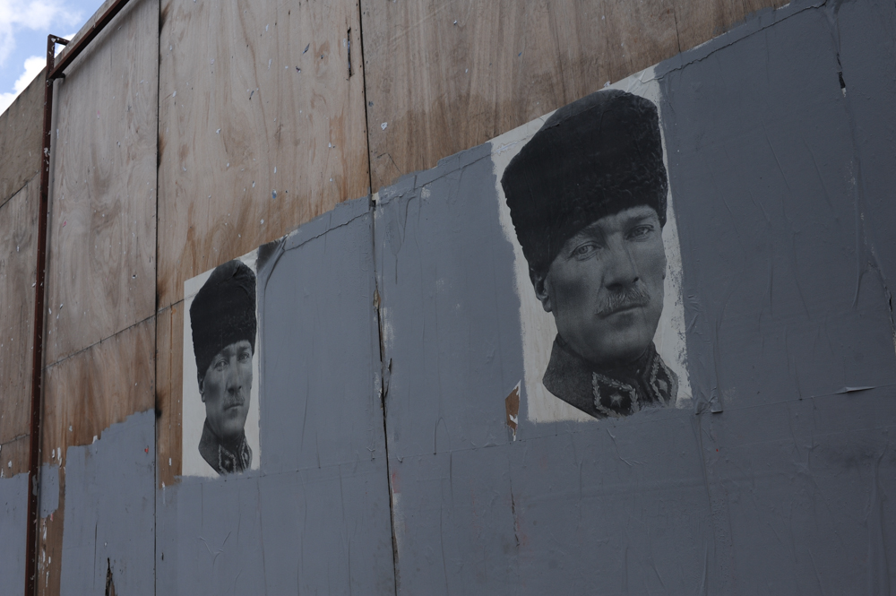 ISTANBUL, TURKEY.  Posters of Mustafa Kemal Ataturk surrounded by painted over graffiti are seen near Taksim Square on June 13, 2013. On the 17th day of protest and periodic riots in Istanbul, many awoke to find graffiti opposing the ruling Justice and Development Party, known by its Turkish acronym AKP, had been painted over by municipal workers overnight.