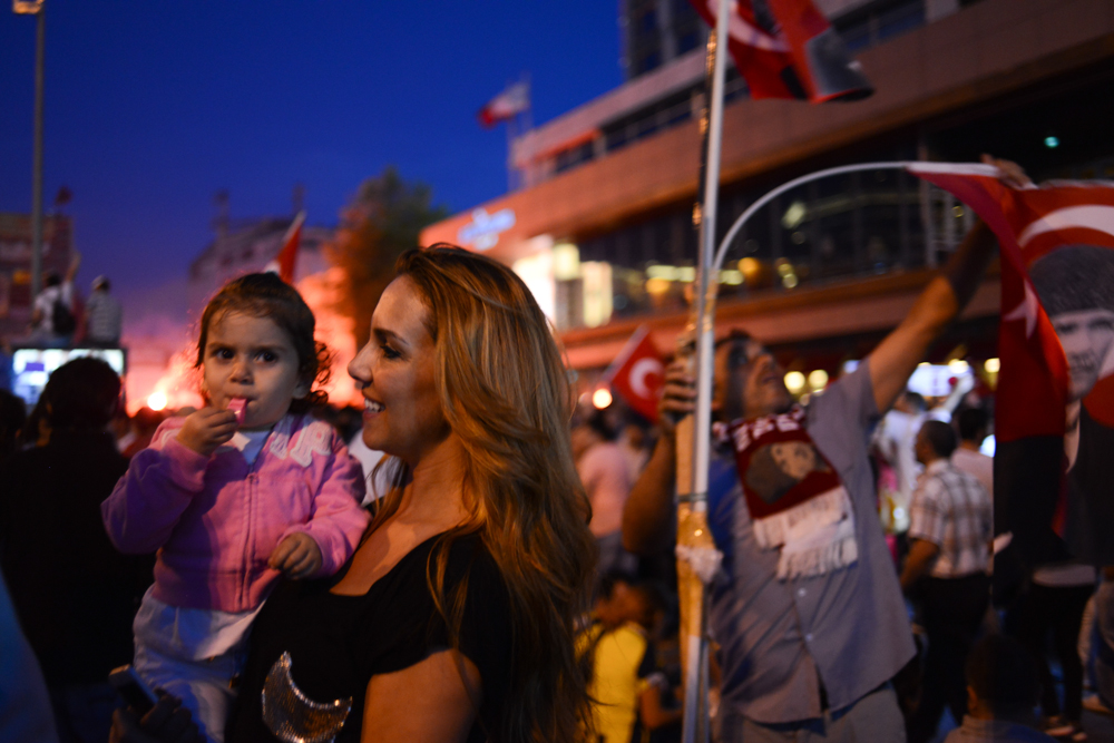 ISTANBUL, TURKEY.  Turks gather in Taksim Square where ongoing protests against the Prime Minister Recep Tayyip Erdogan and his policies a week after demonstrators forced police to withdraw from the square have lead to a carnival-like sit-in on June 8, 2013. A week of protests led to police being barricaded out of and withdrawing from Istanbul's Taksim Square as it transforms increasingly into a free zone; the crisis, which began over construction of a park and plans to reconstruct Ottoman barracks and a shopping mall, has evolved into Turkey's biggest political crisis in decades as Turks express frustration with the current AK Party, Justice and Development Party and Prime Minister Recep Tayyip Erdogan.