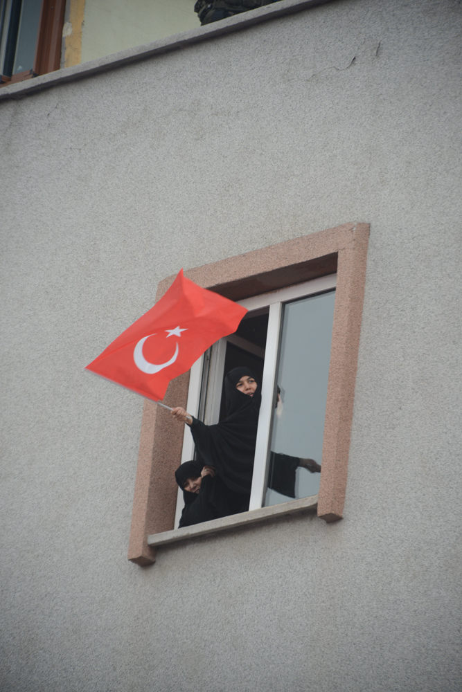 SINCAN, TURKEY.  Religious female supporters of the Justice and Development Party, AKP, and Prime Minister Recep Tayyip Erdogan lean out their window to hear Erdogan speak after more than two weeks straight of protests across Turkey against his rule on June 15, 2013. Sincan is the site of the 1997 {quote}post-modern coup{quote} and where Turkish Prime Minister Recep Tayyip Erdogan chose for his Ankara rally to bolster his position with regard to ongoing protests in Istanbul's Taksim Square and across Turkey; at his rally he said that the security services would promptly take care of the protesters and shortly after riot police were unleashed on the peacefully gathered demonstrators who quickly retook the square.
