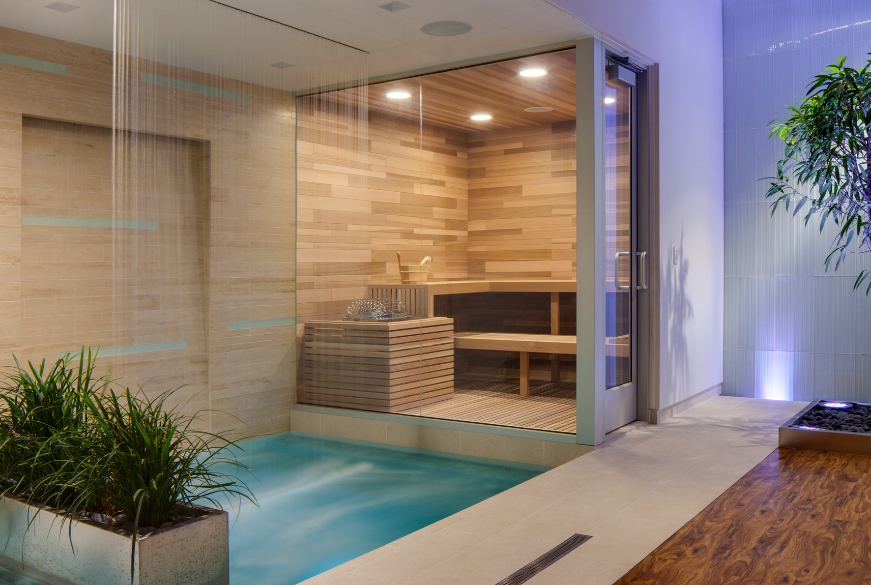 Spa room featuring cascading water, purple LED lighting and a wood clad sauna.Architectural Photography by: Paul Richer / RICHER IMAGES
