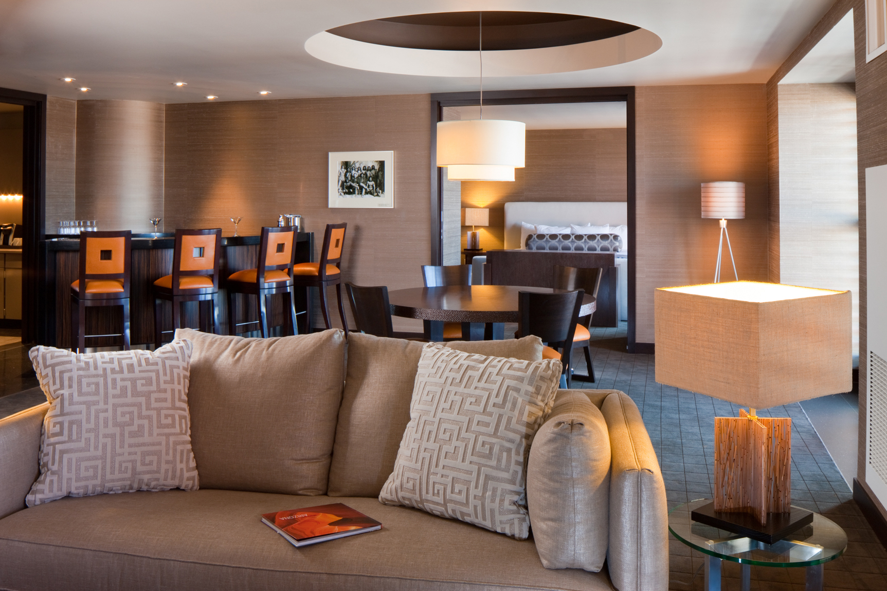 View of living room in a dleuxe suite at a casino in Arizona. Photo has living room, bar space and bedroom. Hospitality, resort, casino, photography in Scottsdale, AZ.