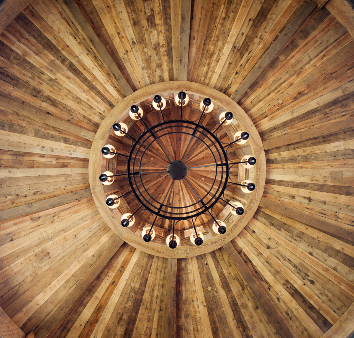 This is an interior detail of the rotunda of raw and reclaimed timber and the chandeleir in a private residence is the Shooting Star Development in Jackson, WY.Architectural Photography by: Paul Richer / RICHER IMAGES