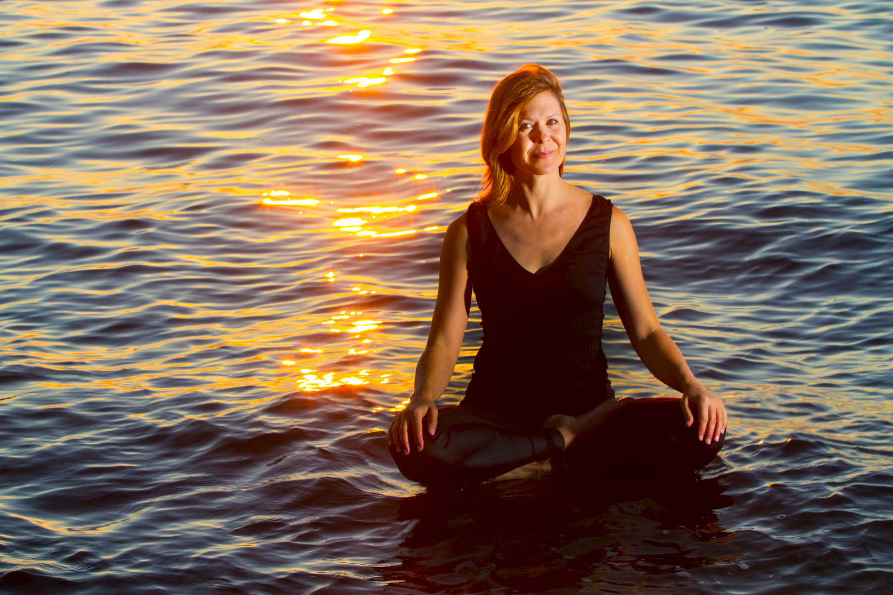 Angeline Johnston, yoga instructor and owner of Richmond Beach Yoga, poses at a beach in Edmonds, Wash. on July 31, 2015(photo © Karen Ducey)
