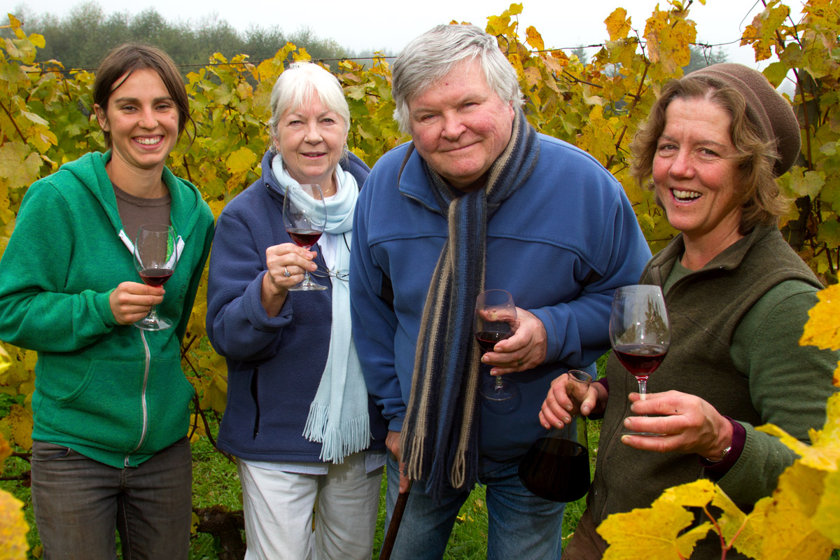 Founders Jo Ann and Gerard Bentryn (center left and right), of Bainbridge Island Vineyards and Winery with Robin Bedony (left) and Betsey Whittick (right). Several farms work on the 40 acre piece of land growing a diversity of crops including lettuce, garlic, beans, squash and potatoes. {quote}We all work cooperatively to create a local food community and culture.{quote} says Whittick.  {quote}Access to land is a challenge for young farmers.{quote} she said and Robin is part of the new generation of farmers, now a working member of Bainbridge Vineyards LLC.  Whittick is in the process of taking over the winery and vineyards operations.