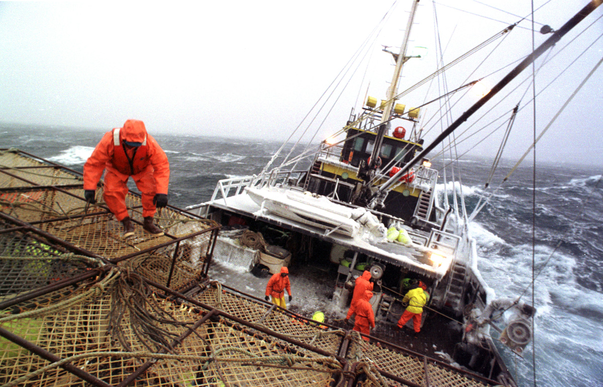 Crewman Joe Hinton works on the stack on the fishing vessel {quote}Reliance{quote}  during a storm in the Bering Sea which took down four boats in four days during opilio crab fishing in February 1994.  Only one crewman lost his life which was considered very fortunate. The Bering Sea is known for having the worst storms in the world.  Crab fishing in the Bering Sea is considered to be one of the most dangerous jobs in the world.  This fishery is managed by the Alaska Department of Fish and Game and is a sustainable fishery.  The Discovery Channel produced a TV series called {quote}The Deadliest Catch{quote} which popularized this fishery.  Today the fishery has been consolidated resulting in a lot less boats participating in this fishery based out of Dutch Harbor, Alaska.