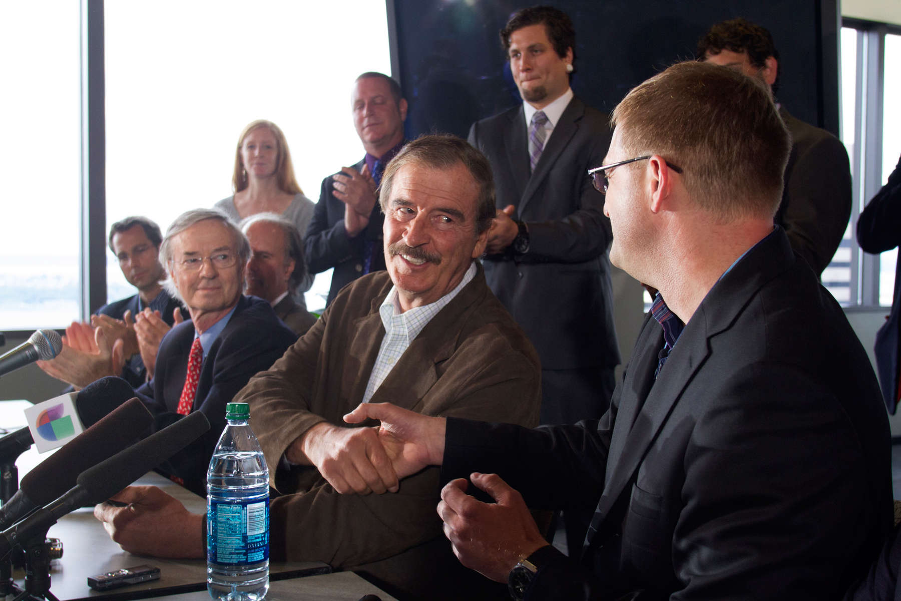 Former Mexican President Vicente Fox (left) shakes hands with  Jamen Shively, (right) Founder and CEO of Diego Pellicer, Inc. during a press conference with other marijuana industry leaders in the Columbia Tower, in Seattle, Wash. on May 30, 2013.