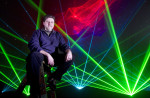 Laser light artist, John Borcherding, poses for a portrait at the Pacific Science Center.