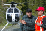 Tony Reece of Hi Line Helicopters speak with bolt cutter Jose Acuna prior to a job in the foothills of North Cascades outside of Concrete, Wash. on May 22, 2007.