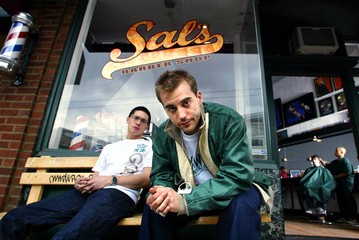 Sal's Barber Shop owners Brian Rauschenbach, left, and Marcus Lalario have groomed their business to cater to the hip-hop crowd, with music in the air and memorabilia on the walls.