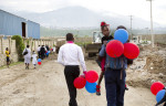 Families leave after graduation ceremonies were held for students of EMPACT NW who were trained in Basic EMT, in Port au Prince, Haiti on September 20, 2011. EMPACT NW is a non-profit based out of Washington state. (photo copyright Karen Ducey)