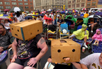 Fred Drake (left) and Aaron Drake (right), age 11, use boxes to shield their heads during the heavy rains which drowned Pacers fans prior to Game 4 of the NBA Finals.  The large screen viewing party across the street from Conseco Fieldhouse attracted thousands of people despite the poor weather.