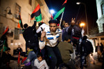 Libyan rebels celebrate their revolution in a square outside the de facto headquarters for the Libyan Revolutionary Council in Bengazi.