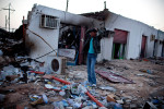 A Libyan stands amidst the rubble of a war-ravaged city street in Brega.