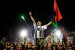 Libyans celebrate the fall of Libyan dictator Moammar Gaddafi in the the newly renamed Martyr's Square