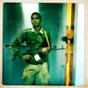 A Libyan rebel guards a hospital ward where captured and wounded Gaddafi loyalist soldiers are being treated.
