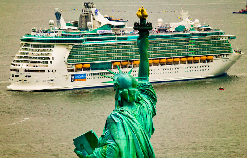 Freedom of the Seas and the Statue of Liberty in Atkin's signature photo for RCCL, resulting in numerous covers of USA Today and world wide press.