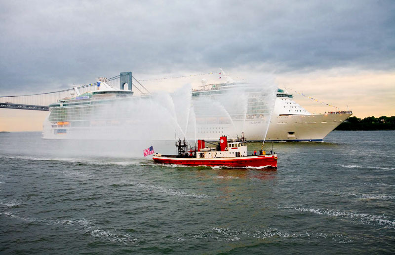 Fireboat John J. Harvey welcomes Freedom of the Seas to NYC.