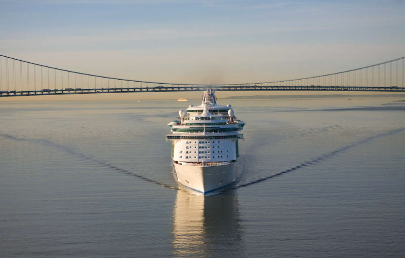 On a rare calm day, Liberty of the Seas sails past Verrazano Bridge.
